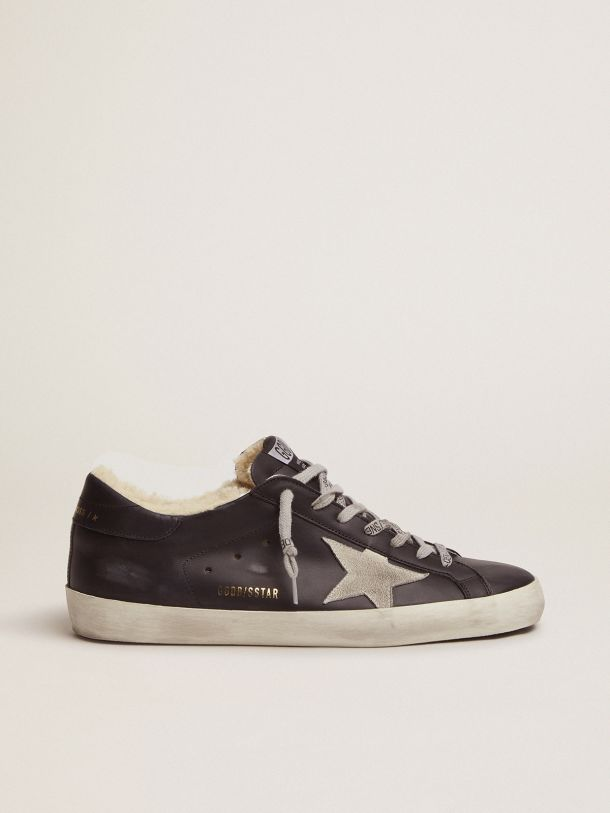 Golden Goose - Super-Star sneakers in black leather with shearling padding in