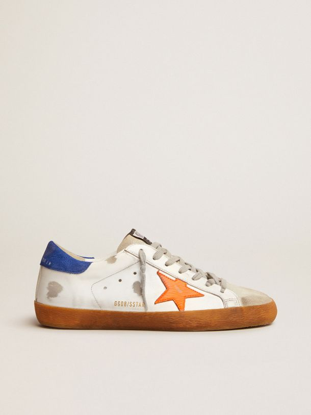 Golden Goose - Super-Star sneakers with blue suede heel tab and neon orange star in