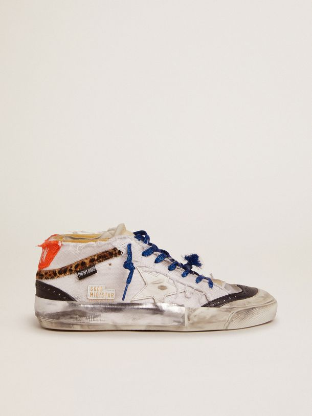 Mid Star sneakers with distressed-finish white canvas upper and multi-foxing