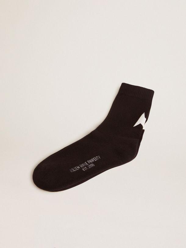 Golden Goose - Calcetines de la Colección Star en color negro con estrella blanca en contraste in