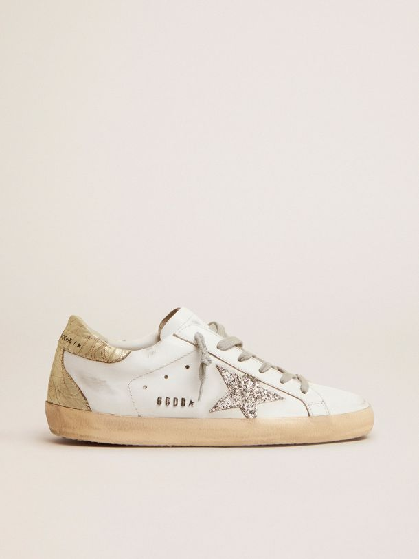 Golden Goose - Super-Star sneakers with silver glitter star and glossy gold leather heel tab in