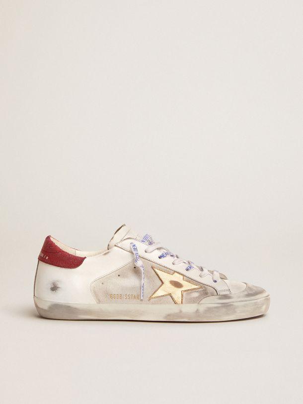 Golden Goose - Sneaker Super-Star Penstar in pelle e suede bianchi con stella dorata in pelle laminata in