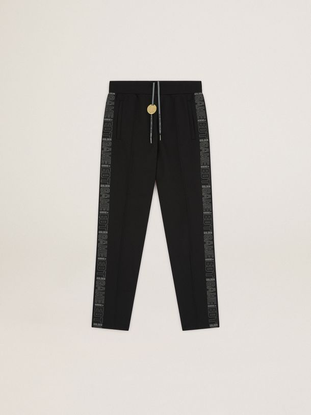 Game EDT Capsule Collection joggers in black with logoed strips on the sides