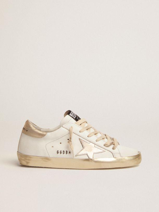 Golden Goose - Sneakers Super-Star avec bande de renfort dorée brillante, clous métalliques et inscription in