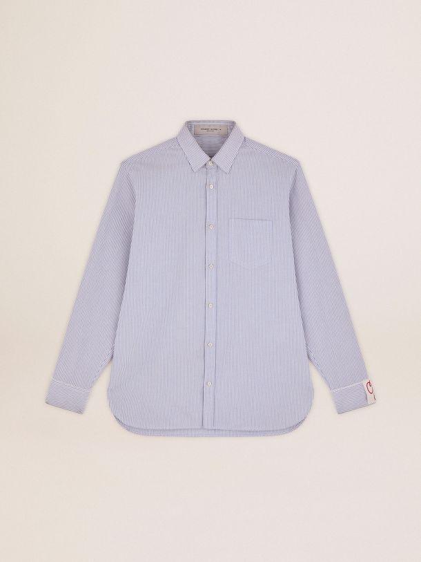 Camisa Oxford de la colección Golden con rayas verticales de color celeste