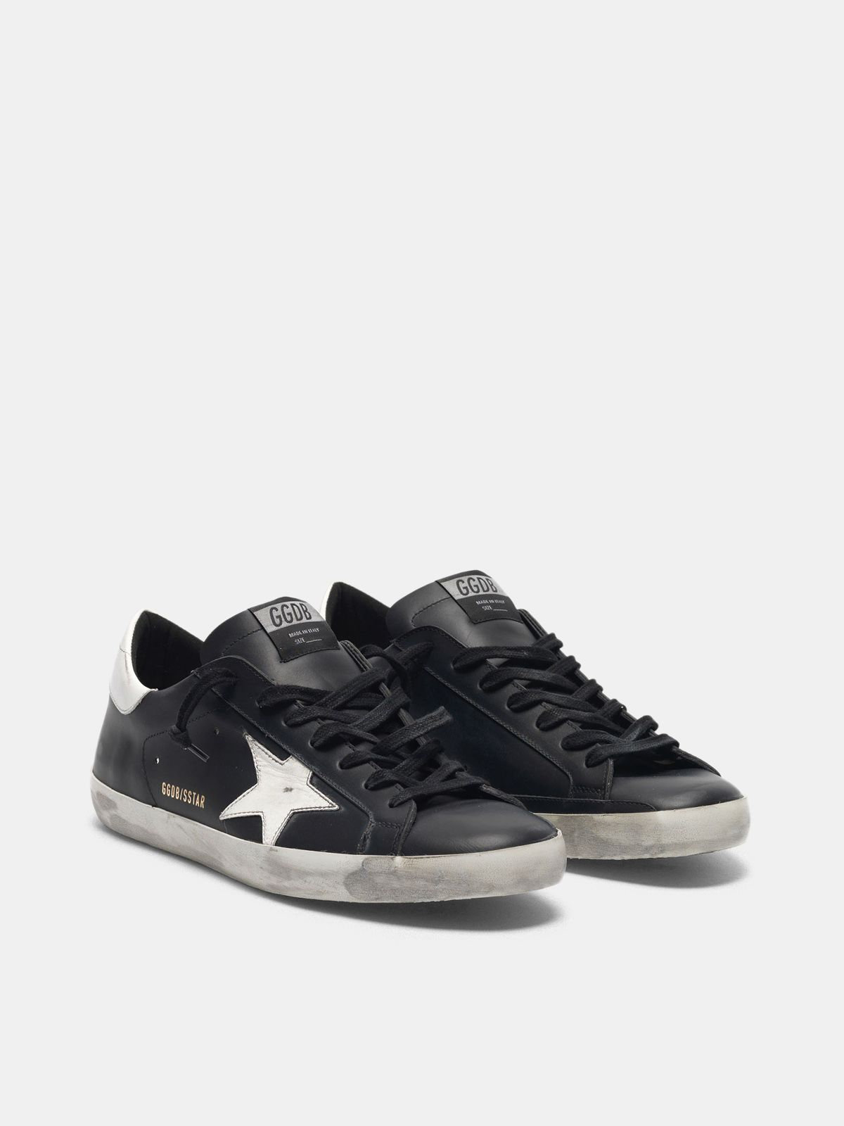 Golden Goose - Sneakers Super-Star nere in pelle con stella bianca in