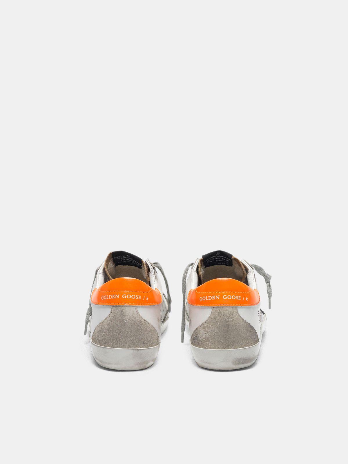 Golden Goose - Sneakers Super-Star con inserto leopardato, stella con glitter e talloncino arancio in