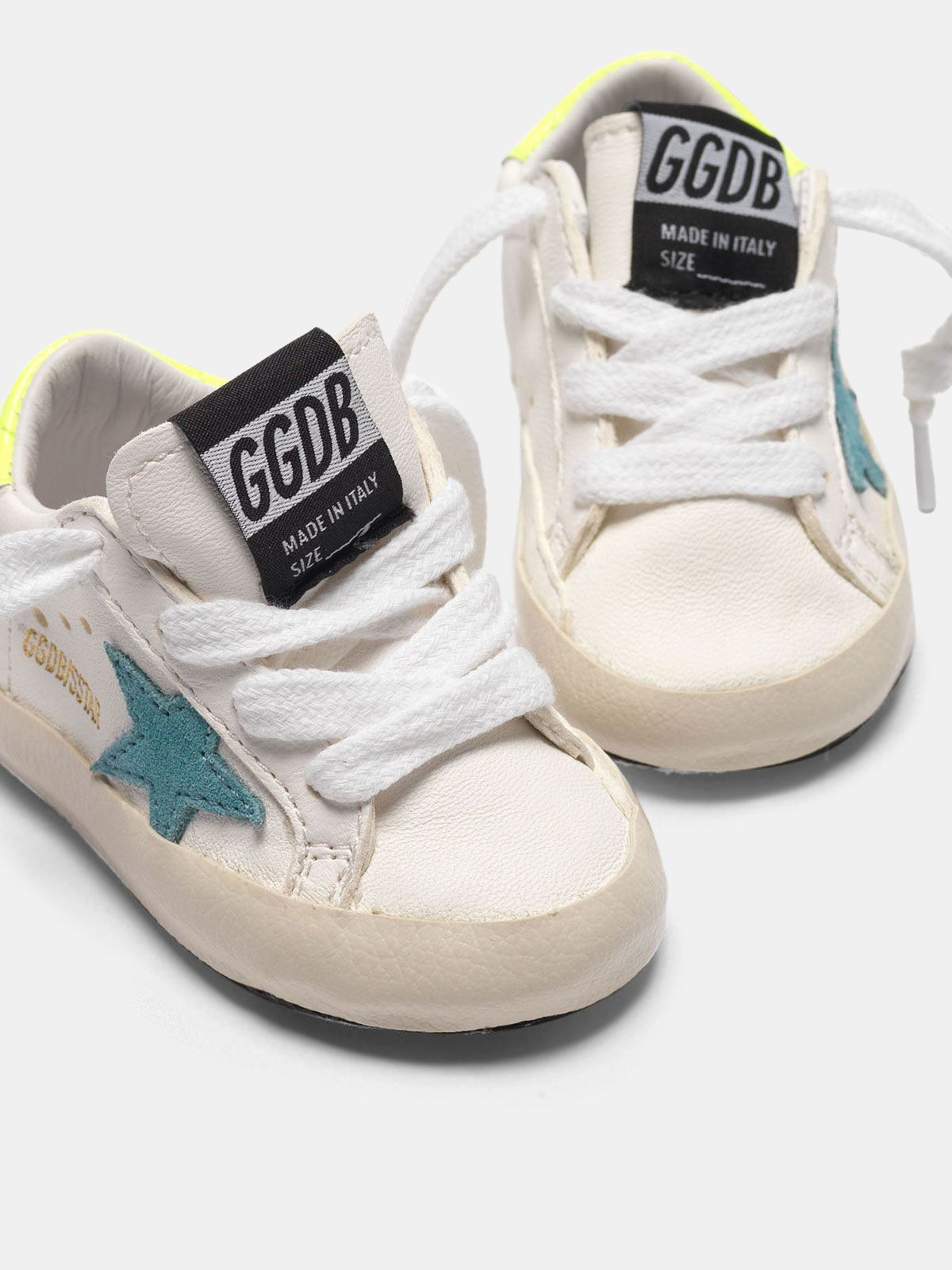 Golden Goose - Super-Star sneakers with blue star and fluorescent yellow heel tab in