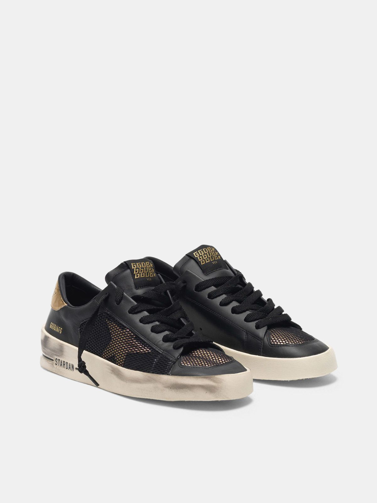 Golden Goose - Stardan sneakers in black and gold leather with mesh inserts in