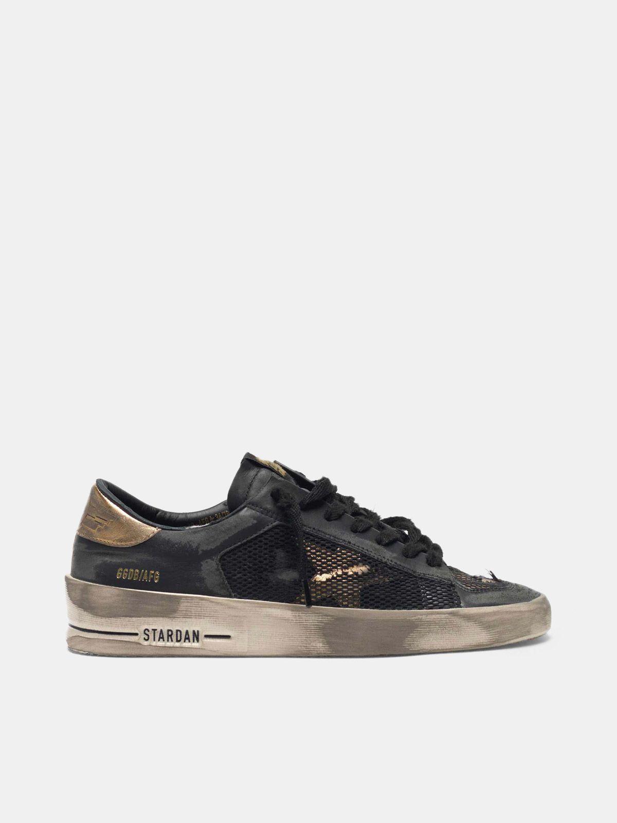 Golden Goose - Distressed black and gold Stardan LTD sneakers  in
