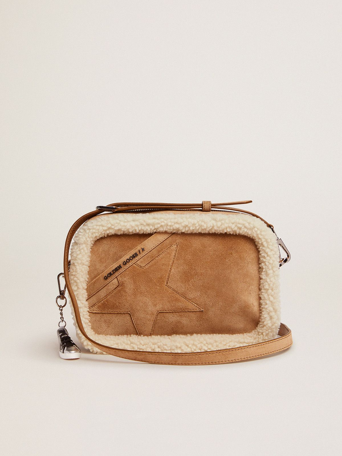 Star Bag made of suede leather with shearling edging