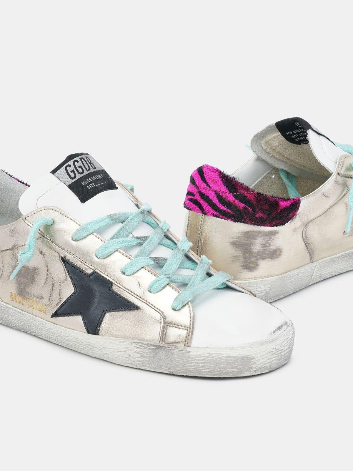 Golden Goose - Gold Super-Star sneakers with zebra-print heel tab in