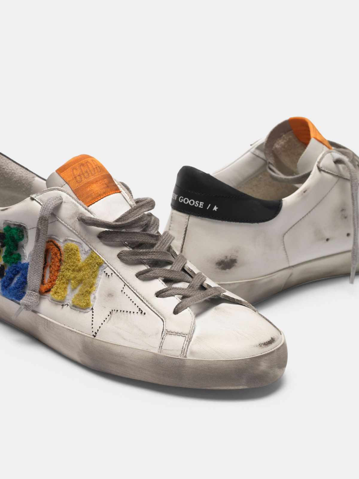 Golden Goose - Sneakers Superstar bianche con patch multicolor in