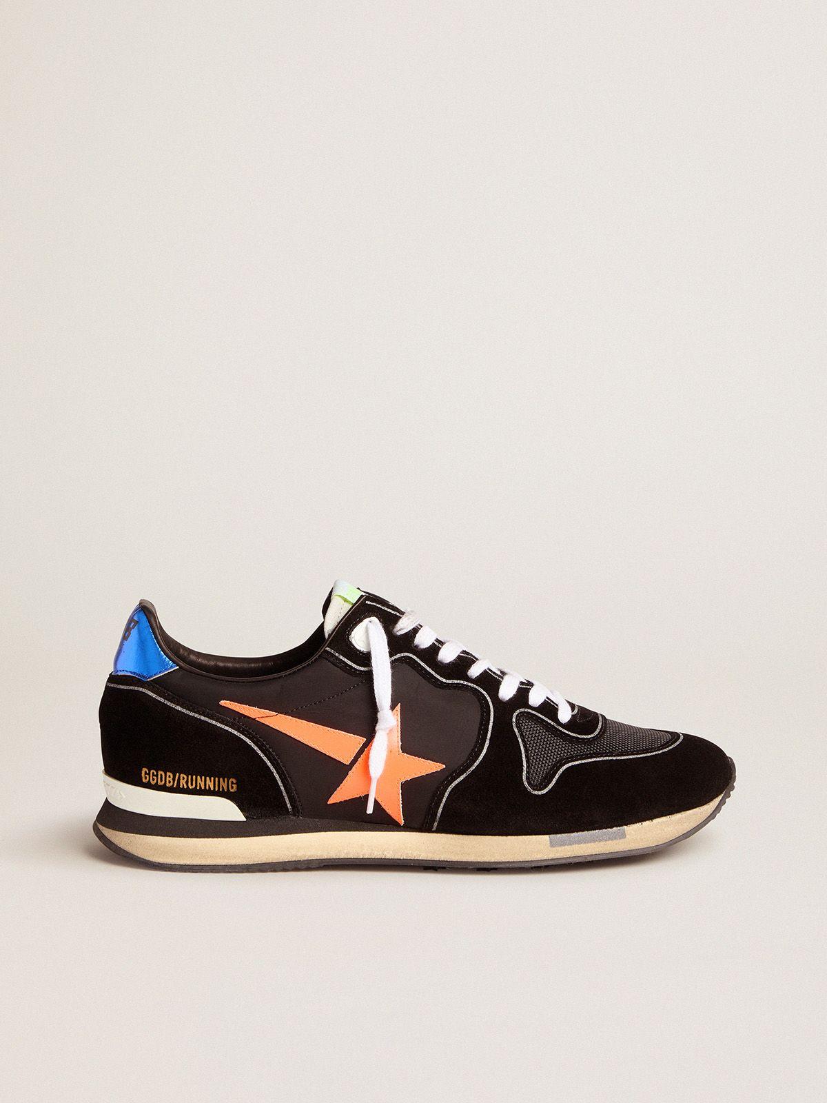 Golden Goose - Black Running sneakers with fluorescent orange star in