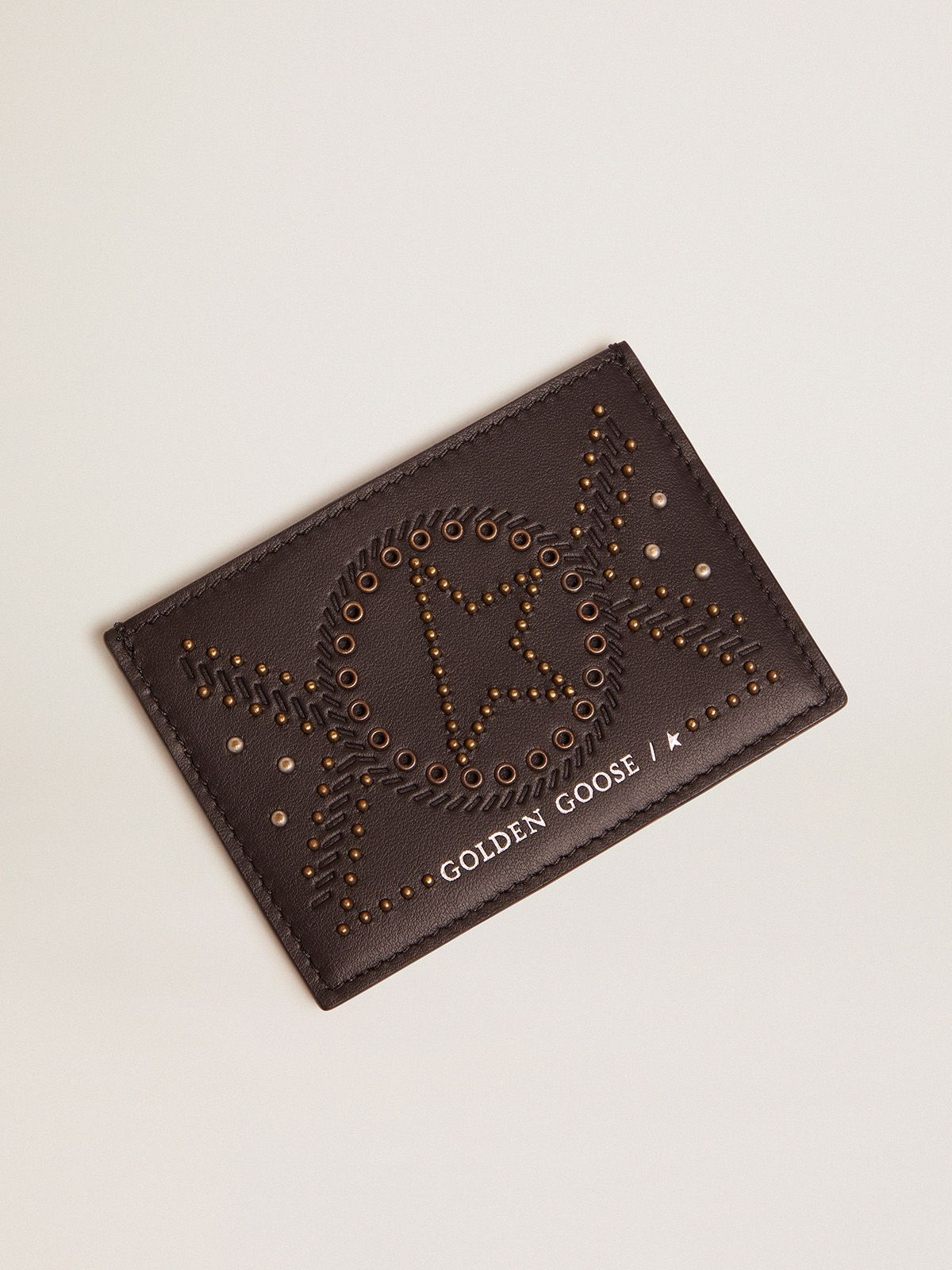 Star card holder in leather with studs