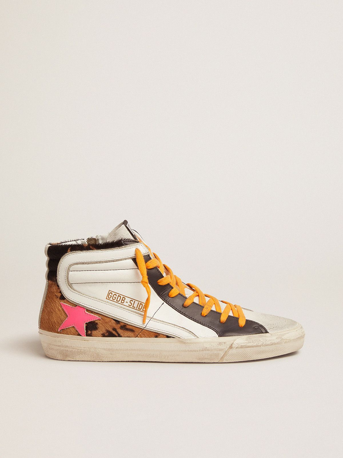 Slide sneakers in pony skin, leather and suede with orange laces and a fuchsia star