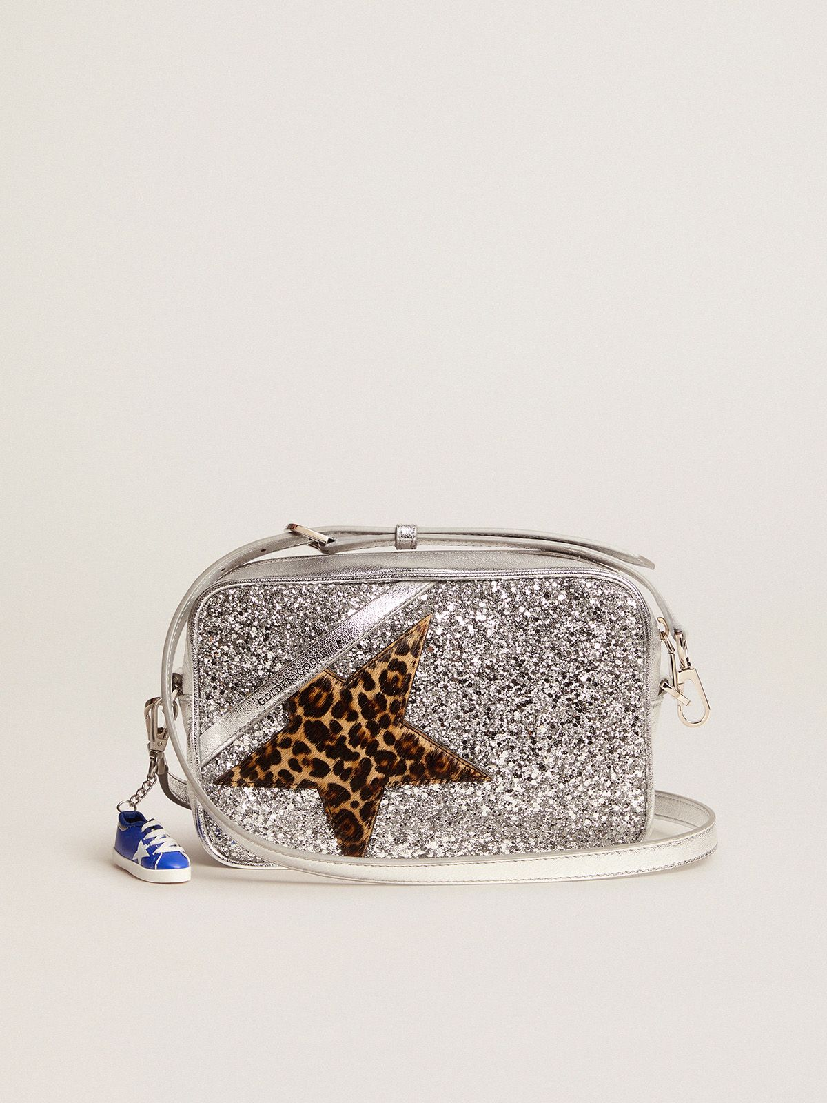 Star Bag in laminated leather with silver glitter and star in leopard-print pony skin.