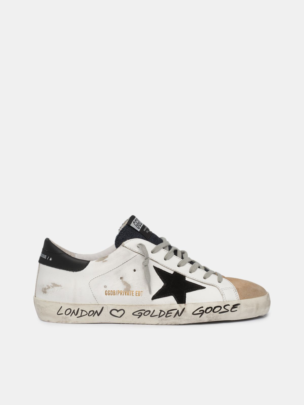 White and beige Super-Star sneakers with handwritten wording